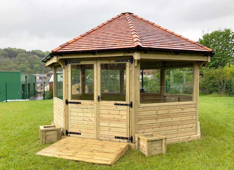 octagonal wooden enclosed outdoor classroom
