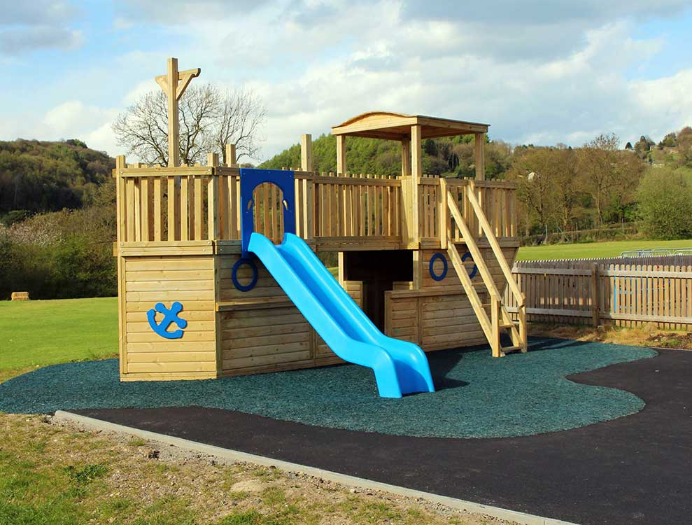 Captain Reubens Pirate Ship Play Tower with Blue Slide and Bonded Rubber Mulch