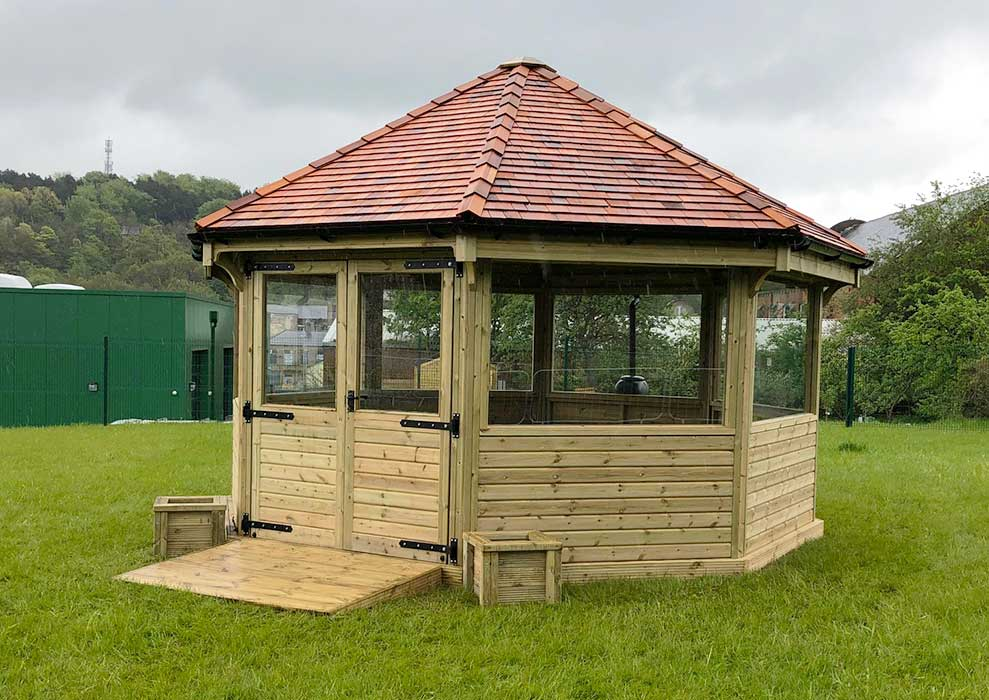 Fully enclosed octagonal wooden shelter